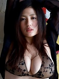 Very busty asian babe showing off her huge melons in a bikini