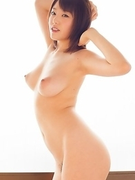 Naughty Japanese babe Mao flaunts her exquisite body and locks her pink bazooka tits on target.