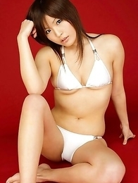 Haruka Yoshimura with boobs in white bra sits with ass up